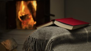 Open book by fireplace.